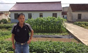 Wu Jianefei and the village home that he built with a lifetime of earnings as a migrant worker